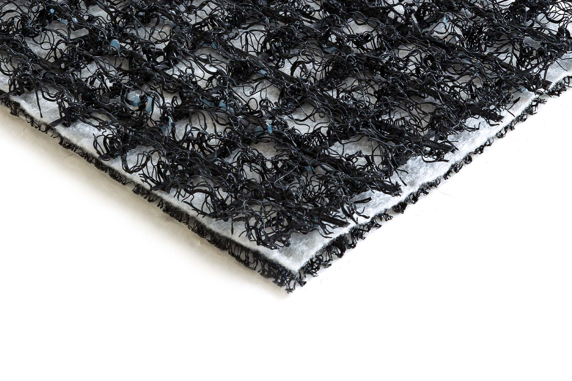 Synthetic monofilaments bonded to filtering geotextile and reinforced geomat