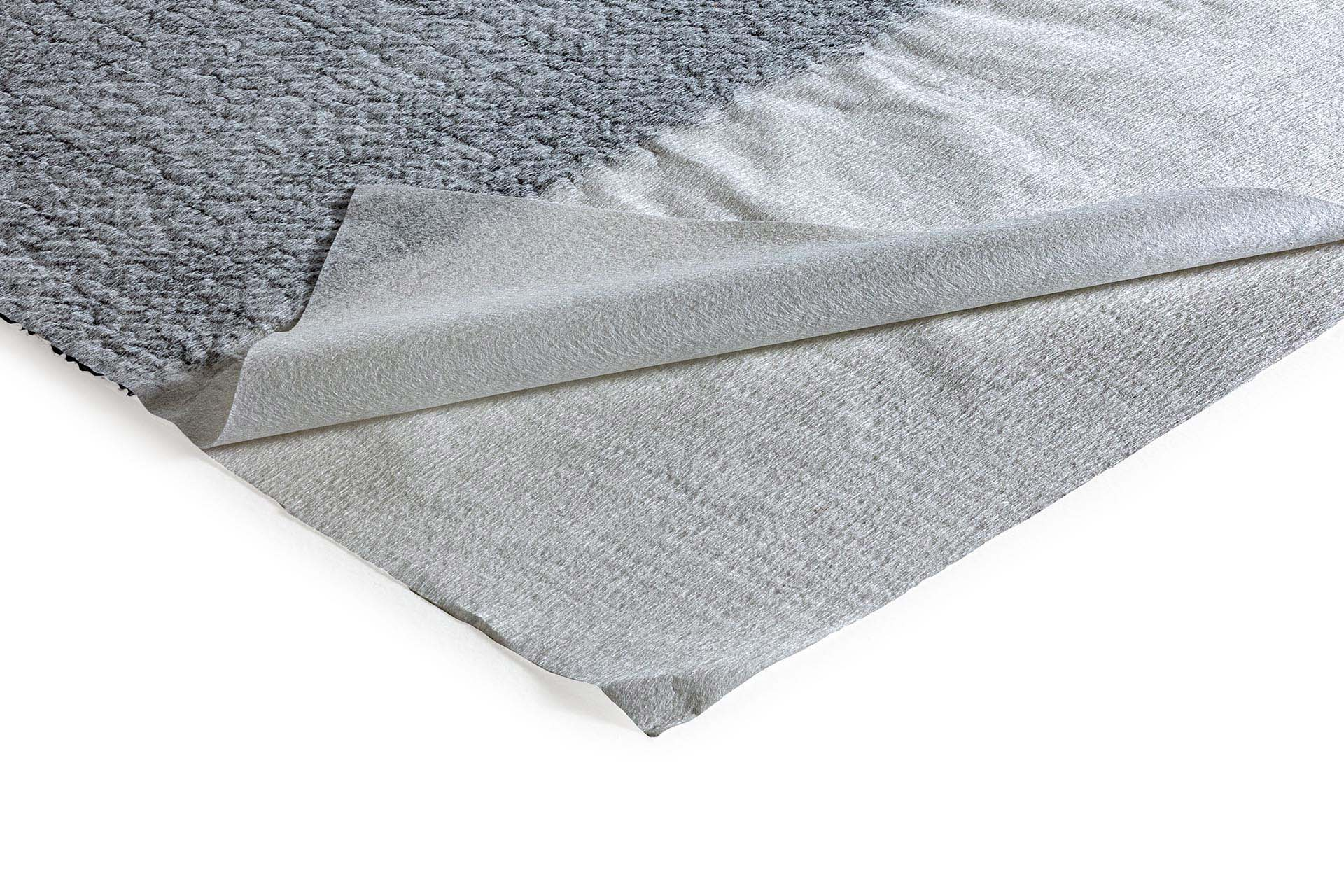 Drainage geocomposite: core of monofilaments, bonded to 2 filtering nonwoven geotextiles